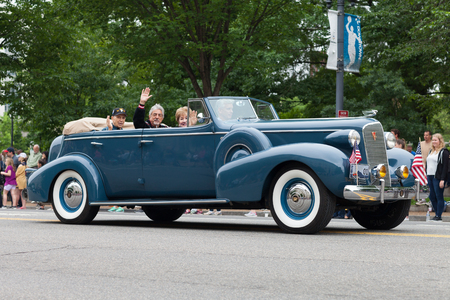 Washington, D.C., USA - May 28, 2018: The National Memorial Day Parade, a cadillac classic car, carry military veteran down constitution avenue