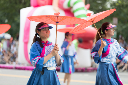 Washington, D.C., USA - July 4, 2018, The National Independence Day Parade, Taiwanese women wearing traditional clothing, walking down constitution avenue during the parade Reklamní fotografie - 116971029