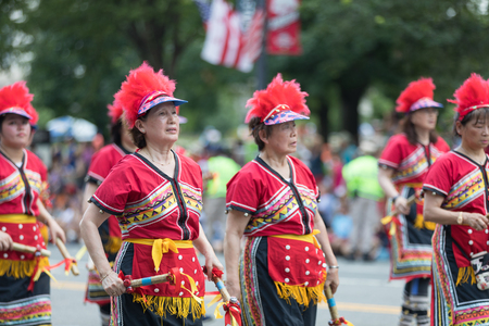 Washington, D.C., USA - July 4, 2018, The National Independence Day Parade, Taiwanese women wearing traditional clothing, walking down constitution avenue during the parade