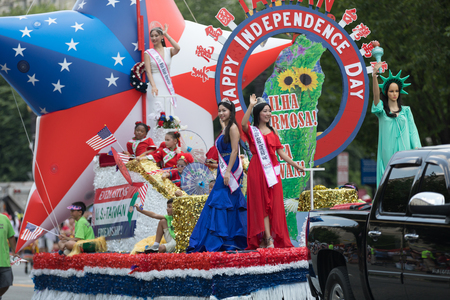 Washington, D.C., USA - July 4, 2018, The National Independence Day Parade, Taiwanese beauty queens on a float, going down constitution avenue during the parade