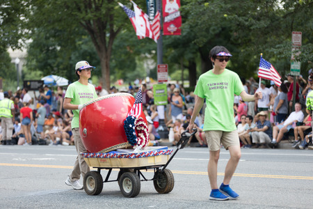 Washington, D.C., USA - July 4, 2018, The National Independence Day Parade, Taiwanese americans, waving american flags and playing a large drum, walking down constitution avenue Redakční
