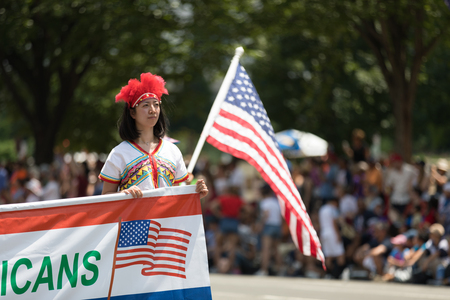 Washington, D.C., USA - July 4, 2018, The National Independence Day Parade, Taiwanese woman wearing traditional clothing , walking down constitution avenue