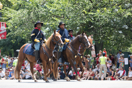 Washington, D.C., USA - July 4, 2018, The National Independence Day Parade, African americans wearing union soldier uniforms from the civil war, riding horses down constitution avenue