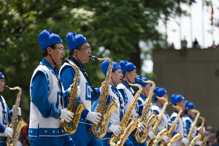 Washington, D.C., USA - July 4, 2018, The National Independence Day Parade, Falun Dafa chinese marching band, wearing traditional clothing, marching down constitution avenue