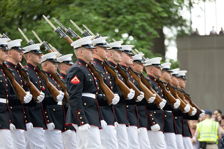 Washington, D.C., USA - July 4, 2018, Members of the US Marine Corps with rifles marching at the National Independence Day Parade 報道画像