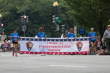 Washington, D.C., USA - July 4, 2018, Young men and women carry a banner that says Americas Independence day parade at the National Independence Day Parade 報道画像