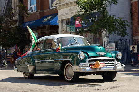 Chicago, Illinois, USA - September 15, 2018: Pilsen Mexican Independence Day Parade, Chevrolet, Styleline, with mexican flags, going down the street