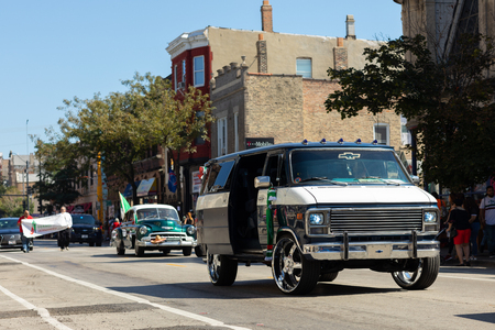 Chicago, Illinois, USA - September 15, 2018: Pilsen Mexican Independence Day Parade, Chevrolet, g-series, van, going down the street