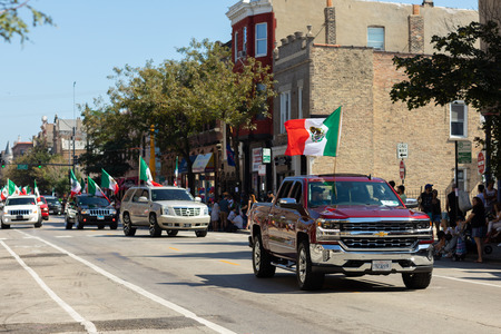 Chicago, Illinois, USA - September 15, 2018: Pilsen Mexican Independence Day Parade, Chevrolet, Silverado, with the mexican flag, going down the street 報道画像