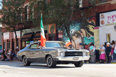 Chicago, Illinois, USA - September 15, 2018: Pilsen Mexican Independence Day Parade, chevrolet, chevelle, with mexican flags, going down the street