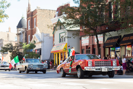 Chicago, Illinois, USA - September 15, 2018: Pilsen Mexican Independence Day Parade, chevrolet, monte Carlo, with mexican flag, going down the street