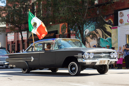Chicago, Illinois, USA - September 15, 2018: Pilsen Mexican Independence Day Parade, chevrolet, impala, with the mexican flag, going down the street