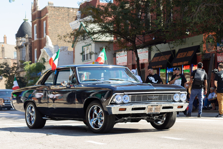Chicago, Illinois, USA - September 15, 2018: Pilsen Mexican Independence Day Parade, Chevrolet, Chevelle, with mexican flags, going down the street 報道画像