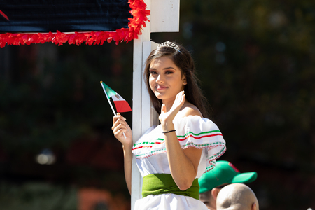 Chicago, Illinois, USA - September 15, 2018: Pilsen Mexican Independence Day Parade, Mexican beauty queen, wearing a crown, going down the street during the parade 写真素材 - 116971421
