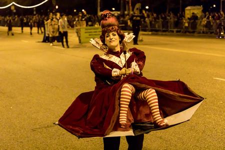 Chicago, Illinois, USA - October 21, 2017: The Arts in the Dark, The Halloween Parade, People wearing colorfull outfits walking down Columbus Street.