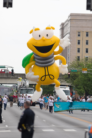 Louisville, Kentucky, USA - May 03, 2018: The Pegasus Parade, Giant balloon in shape of Louie The Lightning Bug, going down the street