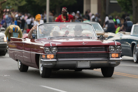 Louisville, Kentucky, USA - May 03, 2018: The Pegasus Parade, a Cadillac Caddy classic car, going down W Broadway during the Parade
