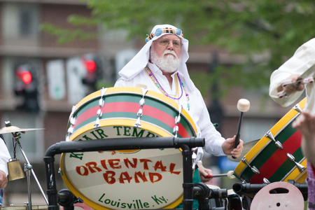 Louisville, Kentucky, USA - May 03, 2018: The Pegasus Parade, Members of Kosair Oriental Band on a float, going down W Broadway Editorial