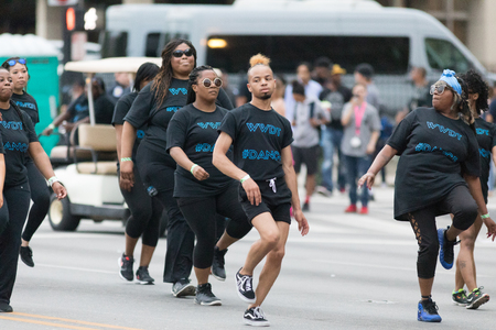 Louisville, Kentucky, USA - May 03, 2018: The Pegasus Parade, Members of the Waterworks Dance Theater, dancing down W Broadway during the parade