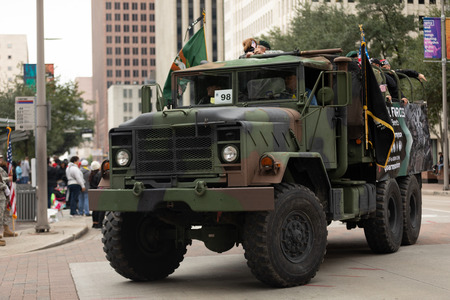 Houston, Texas, USA - November 11, 2018: The American Heroes Parade, A M939 series 5-ton 6x6 truck, Military truck carrying the american flag and members of the green berets