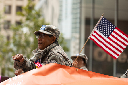 Houston, Texas, USA - November 11, 2018: The American Heroes Parade, Vietnam veteran on a float with the american flag, during the parade Editorial