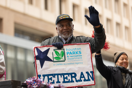 Houston, Texas, USA - November 11, 2018: The American Heroes Parade, African american man, vietnam war veteran, going down the road during the parade Editorial