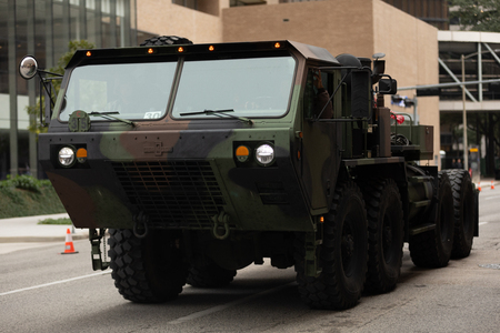 Houston, Texas, USA - November 11, 2018: The American Heroes Parade, a Heavy Expanded Mobility Tactical Truck, Oshkosh m985, going down the road during the parade