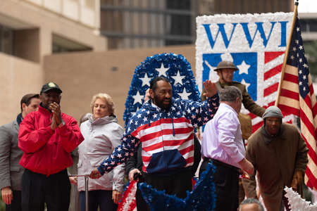 Houston, Texas, USA - November 11, 2018: The American Heroes Parade, Men using civil war union soldier uniforms and carrying muskets and american flags, marching down the road