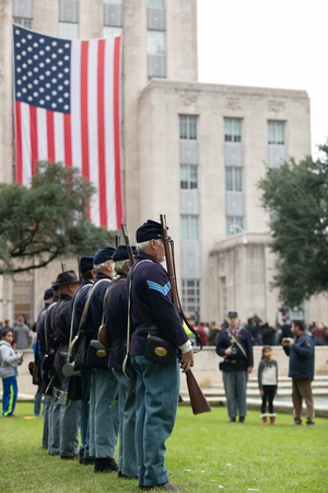 Houston, Texas, USA - November 11, 2018: The American Heroes Parade, Men wearing civil war union uniforms, performing a reenacment infront of Houston's City Hall Editoriali