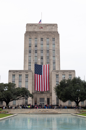 Houston, Texas, USA - November 11, 2018: Houstons City Hall, with a large American flag handing from it. Editorial