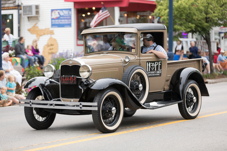 Frankenmuth, Michigan, USA - June 10, 2018: The Bavarian Festival Parade, Vintage ford vehicles, driving down the road during the parade