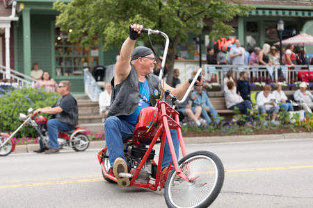 Frankenmuth, Michigan, USA - June 10, 2018: The Bavarian Festival Parade, Men riding costum build motorcycles on the street during the parade Editöryel