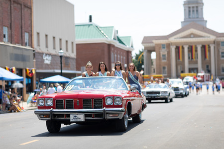 Jasper, Indiana, USA - August 5, 2018: The Strassenfest Parade, A group of Beauty queens, riding on the back of a classic car during the parade