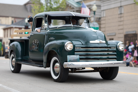 Stoughton, Wisconsin, USA - May 20, 2018: Annual Norwegian Parade, A chevrolet pickup truck classic, going down the road during the parade 写真素材 - 117154356