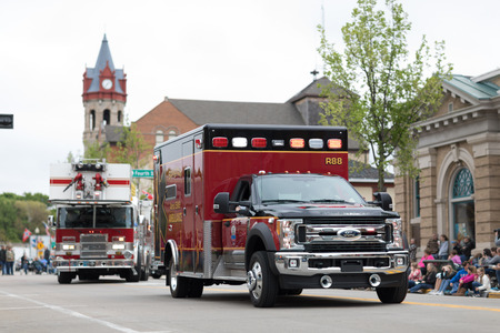 Stoughton, Wisconsin, USA - May 20, 2018: Annual Norwegian Parade, an ambulance of the Stoughton Area EMS, driving by, during the parade Editöryel