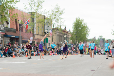 Stoughton, Wisconsin, USA - May 19, 2018: Syttende Mai Youth Parade, Members of the Stoughton Tumblers Competitive Team, performing stuns during the parade Redakční