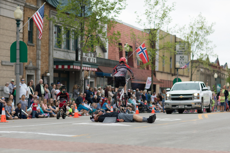 Stoughton, Wisconsin, USA - May 19, 2018: Syttende Mai Youth Parade, Children riding mountain bicycles, with protective gear, during the parade
