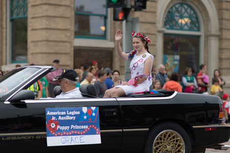 Stoughton, Wisconsin, USA - May 19, 2018: Syttende Mai Youth Parade, The American Legion Jr. Auxiliary Poppy Princess, riding on a car