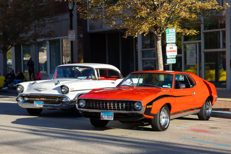Springfield, Illinois, USA - September 22, 2018: The Route 66 Mother Road Festival, AMC Javelin SST, next to a Chevrolet Bel Air, on the streets of downtown Springfield