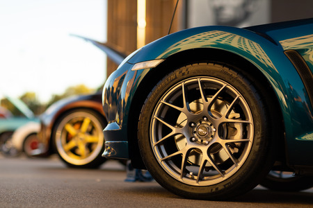 Springfield, Illinois, USA - September 22, 2018: The Route 66 Mother Road Festival, Front wheel close up of a 2007 Mazda RX-8 on the streets of downtown Springfield
