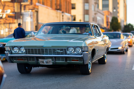 Springfield, Illinois, USA - September 22, 2018: The Route 66 Mother Road Festival, Chevrolet Impala being driven on the streets of downtown Springfield 報道画像