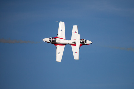 CT-114 Tutor of the Snorbirds canadian forces demostration squadron, performing aerobatics, precision flying.