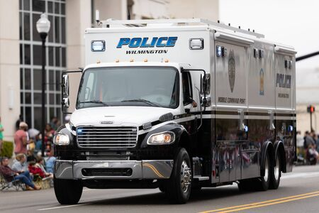 Wilmington, North Carolina, USA - April 6, 2019: The North Carolina Azalea Festival, Freightliner Mobile Command Post from wilmington police, driving down the road during the parade
