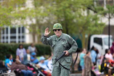 Wilmington, North Carolina, USA - April 6, 2019: The North Carolina Azalea Festival, United States Military veterans, going down 3rd street during the parade Editorial