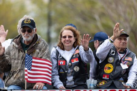 Wilmington, North Carolina, USA - April 6, 2019: The North Carolina Azalea Festival, United States Military Veterans members of the american honor guards being transported down 3rd st at the parade