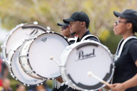 Wilmington, North Carolina, USA - April 6, 2019: The North Carolina Azalea Festival, Members of Mt. Carmel Baptist Church Bishop C. V. Russell Jr. Marching Ambassadors, performing at the parade