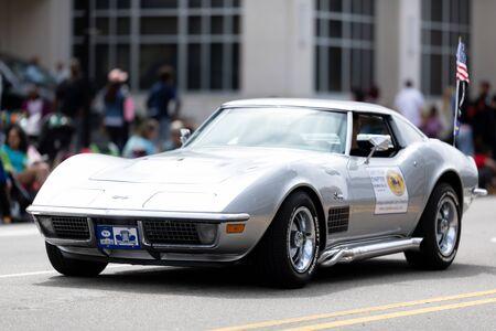 Wilmington, North Carolina, USA - April 6, 2019: The North Carolina Azalea Festival, Chevrolet Corvette carrying the american flag down 3rd street at the parade