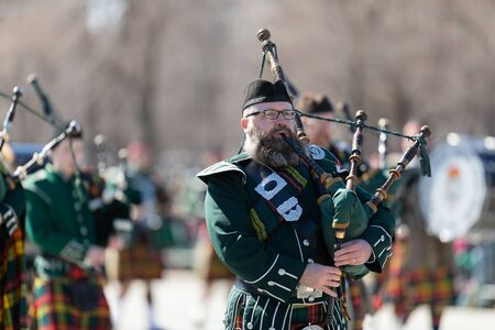 Chicago, Illinois, USA - March 16, 2019: St. Patricks Day Parade, Bagpipe band, marching down columbus dr at the parade