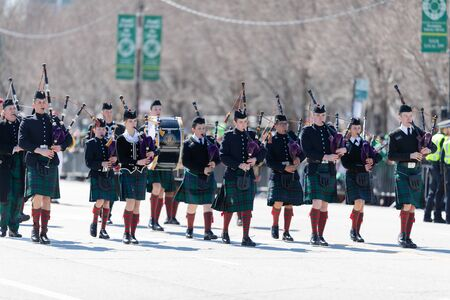 Chicago, Illinois, USA - March 16, 2019: St. Patrick's Day Parade, Members of the Johns Northwestern Military Academy from Delafield, Wisconsin, marching down columbus dr Фото со стока - 129744050