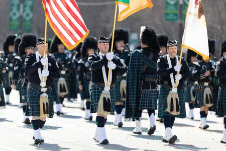 Chicago, Illinois, USA - March 16, 2019: St. Patricks Day Parade, The Bagpipes and Drums of the Emerald Society Chicago Police Department performing at the parade